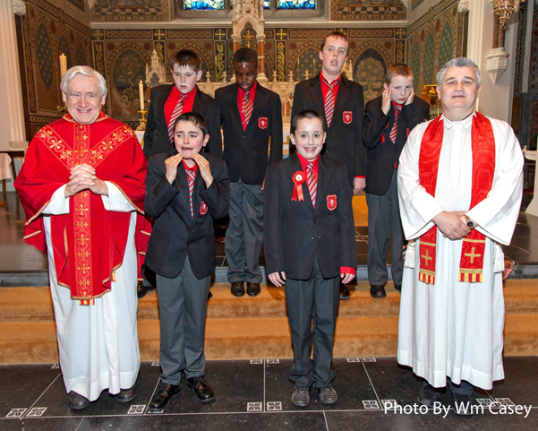Holy Family School Confirmation Class 2015 all smiles  with Canon Cotter and Fr. Naughton.